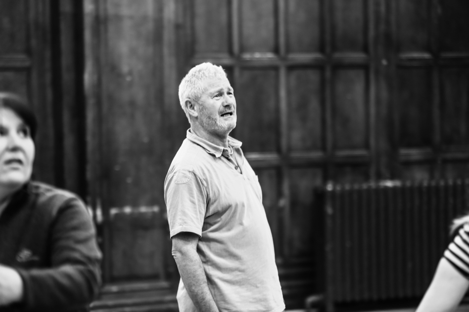 man standing at acting class