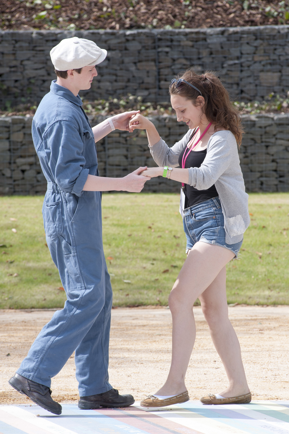 boy in boiler suit dancing with a girl