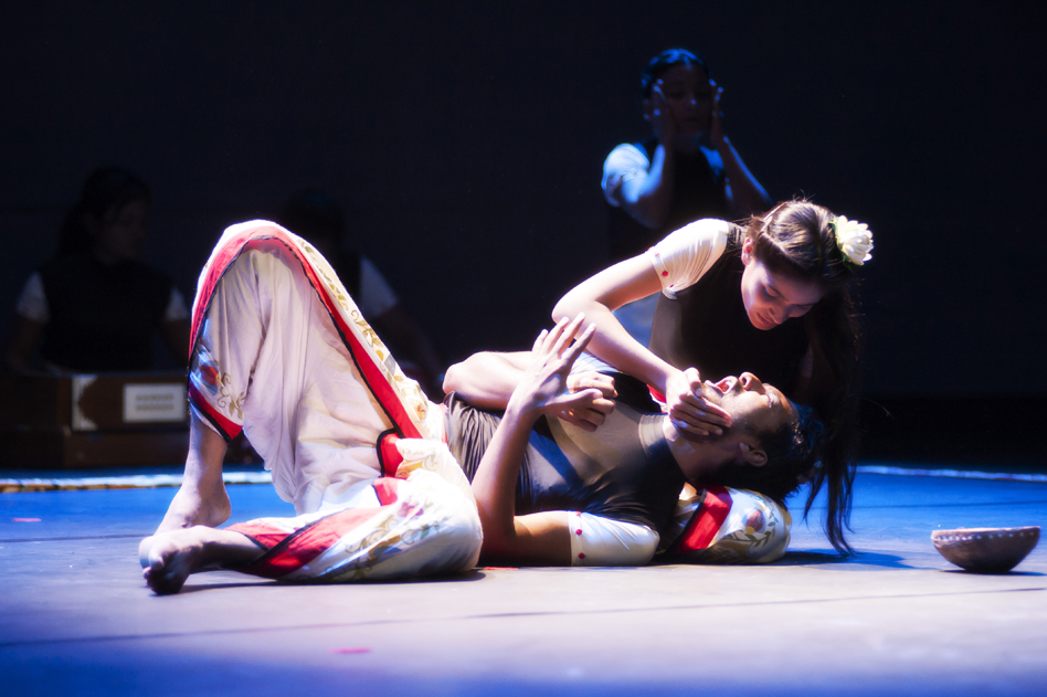 man and woman lying on stage