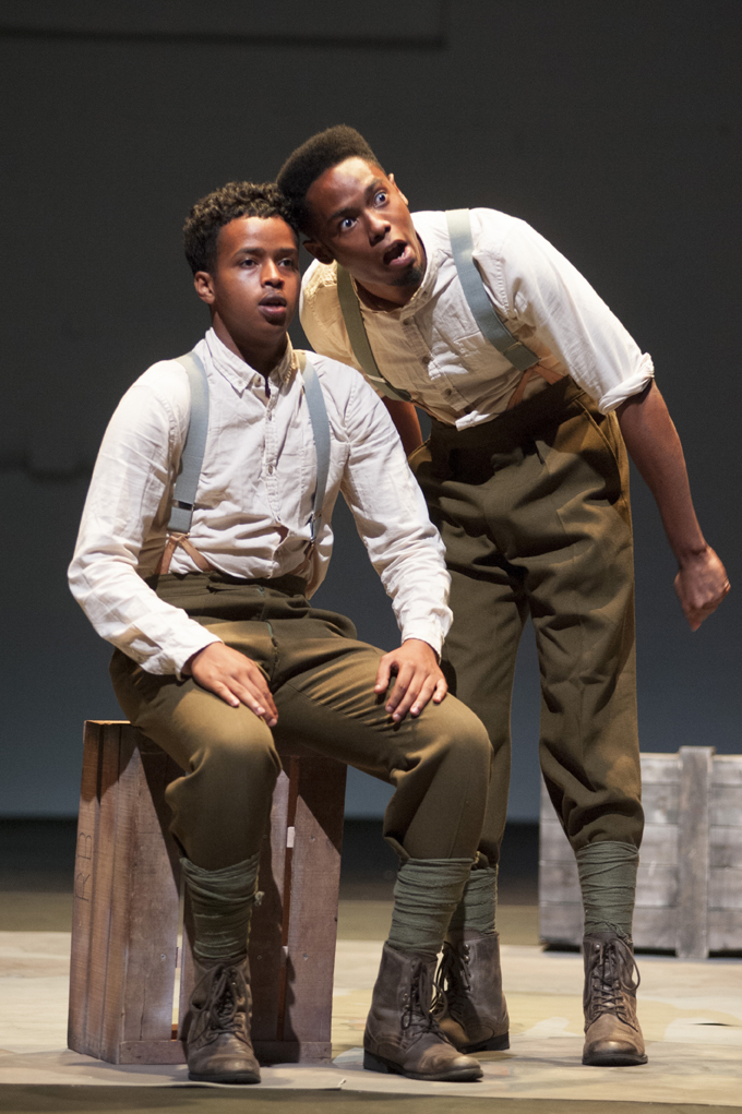 two actors dressed brown trousers white shirts and braces