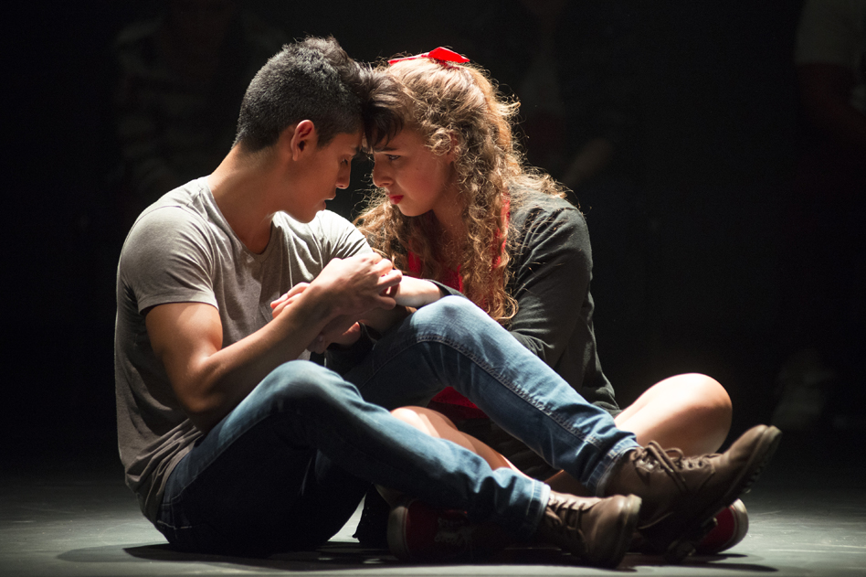 boy and girl sitting on stage facing each other